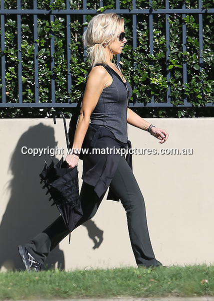 26 MARCH 2017 SYDNEY AUSTRALIA<br /> WWW.MATRIXPICTURES.COM.AU<br /> <br /> EXCLUSIVE PICTURES<br /> <br /> Danielle Spencer pictured walking through Rose Bay where she stopped to chat to ex husband Russell Crowe as he drove the boys back home. Danielle's new boyfriend Adam Long was spotted at the front gate. <br /> <br /> <br /> Note: All editorial images subject to the following: For editorial use only. Additional clearance required for commercial, wireless, internet or promotional use.Images may not be altered or modified. Matrix Media Group makes no representations or warranties regarding names, trademarks or logos appearing in the images.