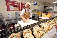 Sam Lane at the Make Your Own Pizza counter