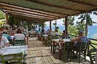 Greece, Ionian Islands, Paxos: Greek restaurant on Monodendri beach | Griechenland, Ionische Inseln, Paxos: Griechisches Restaurant am Monodendri beach