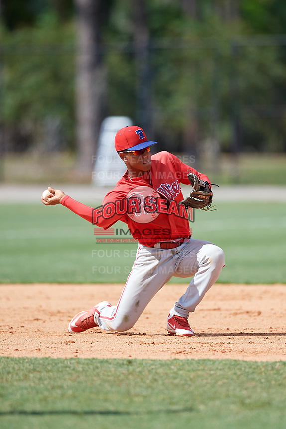 Philadelphia Phillies shortstop Guarner Dipre (28) throws to first base during an Instructional League game against the Detroit Tigers on September 19, 2019 at Tigertown in Lakeland, Florida.  (Mike Janes/Four Seam Images)