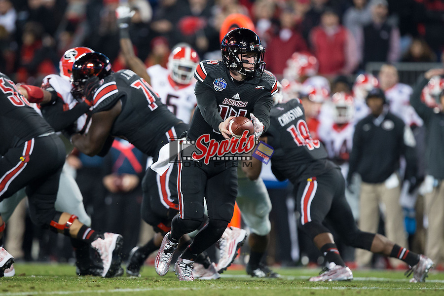 Kyle Bolin (14) of the Louisville Cardinals turns to hand the ball off during first half action against the Georgia Bulldogs at the Belk Bowl at Bank of America Stadium on December 30, 2014 in Charlotte, North Carolina.  The Bulldogs defeated the Cardinals 37-14.  (Brian Westerholt/Sports On Film)