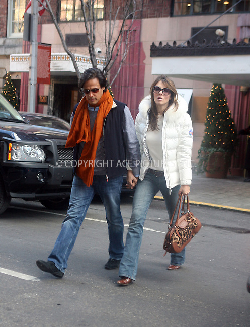 WWW.ACEPIXS.COM....January 31 2007, New York City....British actress Liz Hurley and her fiance Arun Nayar leave their midtown hotel and cross the street to eat in a French restaurant. They joked and laughed with one another for about an hour before returning hand in hand to the hotel.....Please byline: PHILIP VAUGHAN/ACEPIXS.COM....For information please contact Philip Vaughan:..tel: 212 243 8787 or 646 769 0430..e-mail: info@acepixs.com..website: www.acepixs.com
