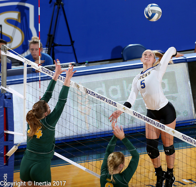BROOKINGS, SD - SEPTEMBER 24: Hanna Jellema #5 from South Dakota State winds up to get a kill past Erika Gelzinyte #14 from North Dakota State during their match Sunday evening at Frost Arena in Brookings. (Photo by Dave Eggen/Inertia)