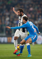 Calcio, Serie A: Juventus Stadium. Torino, Juventus Stadium, 29 ottobre 2016.<br /> Juventus' Gonzalo Higuain, left, is challenged by Napoli's Vlad Chiriches  during the Italian Serie A football match between Juventus and Napoli at Turin's Juventus Stadium, 29 October 2016. Juventus won 2-1.<br /> UPDATE IMAGES PRESS/Isabella Bonotto