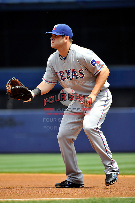 Texas Rangers first baseman Mitch Moreland #18 during a game against the New York Yankees at Yankee Stadium on June 16, 2011 in Bronx, NY.  Yankees defeated Rangers 3-2.  Tomasso DeRosa/Four Seam Images