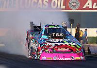 Feb 6, 2015; Pomona, CA, USA; NHRA funny car driver Courtney Force during qualifying for the Winternationals at Auto Club Raceway at Pomona. Mandatory Credit: Mark J. Rebilas-
