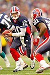 9 October 2005: Kelly Holcomb (10), quarterback for the Buffalo Bills, sets for a handoff to runningback Willis McGahee (21) in a divisional game against the Miami Dolphins on October 9, 2005 at Ralph Wilson Stadium, in Orchard Park, NY. The Bills defeated the long rivaled Dolphins 20-14. ..Mandatory Photo Credit: Ed Wolfstein