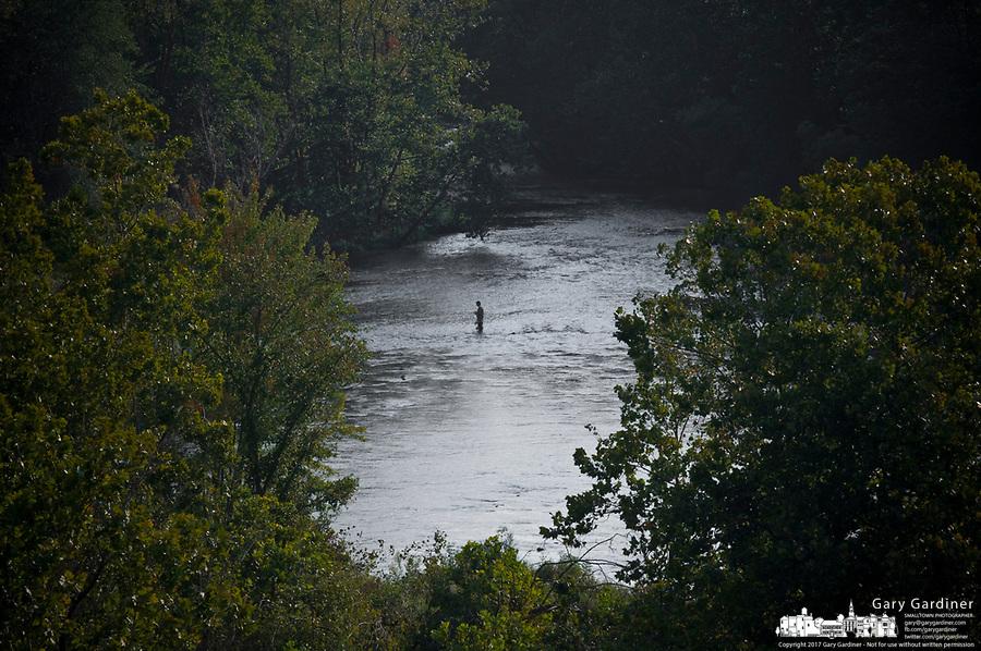 Fisherman in waters below Hoover Reservoir wading in Big Walnut Creek.