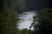 Fisherman in waters below Hoover Reservoir wading in Big Walnut Creek.