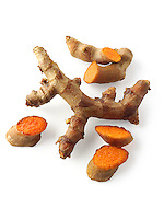 Fresh turmeric  or tumeric root (Curcuma longa) against a white background