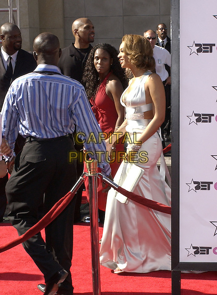 BEYONCE.The 4th Annual BET Awards held at The Kodak Theatre in Hollywood, California .June 29,2004.full length, white dress, avoiding press line, bag, purse.www.capitalpictures.com.sales@capitalpictures.com.Supplied By Debbie Van Story