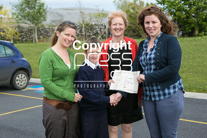 Pictured at the presentation of certificated by EcoEco Beo to students from New Quay National school were: Bridget Barry,Burren Beo Trust, Student Paddy Nolan, Carmel Thynne, Principal New Quay NS, Aine Bird, Eco Beo Co ordinator . Pictured Credit Brian Gavin Press 22