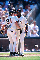 SAN FRANCISCO, CA - Barry Bonds of the San Francisco Giants restrains his teammate Jeff Kent from attacking the home plate umpire during a game at Pacific Bell Park in San Francisco, California in 2002. Photo by Brad Mangin
