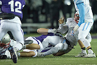 NWA Democrat-Gazette/CHARLIE KAIJO Fayetteville High School Dotson Schaefer (49) sacks Southside High School quarterback Taye Gatewood (5) during a playoff football game on Friday, November 10, 2017 at Fayetteville High School in Fayetteville.