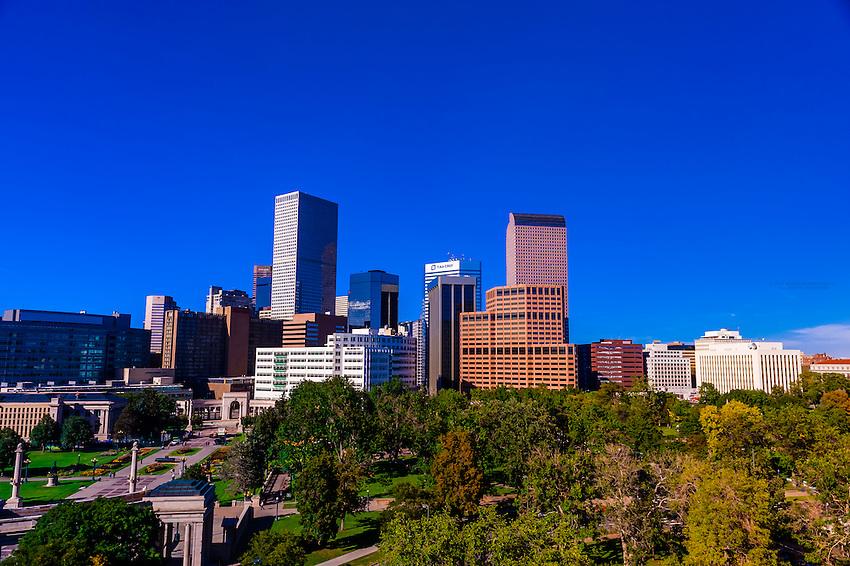 Downtown Denver skyline with Civic Center Park in foreground, Denver, Colorado USA.