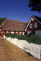 Denmark, Romo, Jylland, Scandinavia, Europe, Red farmhouse with thatched roof on Romo Island.