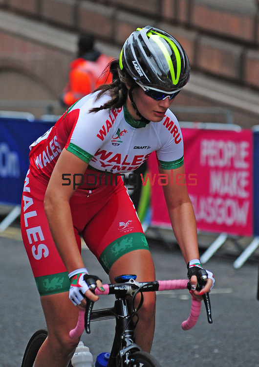 Wales' Hayley Jones prepares to take the corner from George Street to Montrose Street, Glasgow<br /> <br /> Photographer Chris Vaughan/Sportingwales<br /> <br /> 20th Commonwealth Games - Day 11 - Sunday 3rd August 2014 - Cycling - Road Race - Glasgow - UK