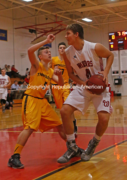 Litchfield, CT-011416MK17 Wamogo's Garrett Coe drives against Thomaston's Devan Donofrio during Berkshire League action Thursday night at Wamogo High School.  Wamogo defeated Thomaston 49 - 27. Michael Kabelka Republican-American