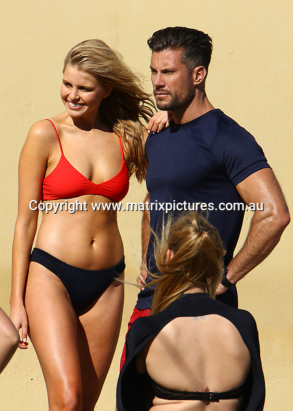 16 AUGUST 2017 SYDNEY AUSTRALIA<br /> WWW.MATRIXPICTURES.COM.AU<br /> <br /> EXCLUSIVE PICTURES<br /> <br /> Tegan Martin pictured at a 'Baywatch' themed photoshoot with Sam Wood at Tamarama Beach. <br /> <br /> Note: All editorial images subject to the following: For editorial use only. Additional clearance required for commercial, wireless, internet or promotional use.Images may not be altered or modified. Matrix Media Group makes no representations or warranties regarding names, trademarks or logos appearing in the images.