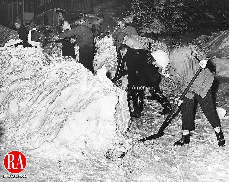 Residents clearing Grove Street in Naugatuck. <br /> <br /> The blizzard of January 19-20 1961 was the second of three major winter storms that winter. The average snowfall in Connecticut reported for that storm was approximately 2'. 20 January 1961.