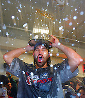 Johnny Damon celebrates in Red Sox clubhouse with the World Series trophy. Baseball: 2004 World Series. St. Louis Cardinals vs Boston Red Sox. St. Louis, MO 10/27/2004 MANDATORY CREDIT: Brad Mangin/MLB Photos