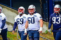 June 6, 2017: New England Patriots ceter David Andrews (60) walks to practice in the rain at the New England Patriots mini camp held on the practice field at Gillette Stadium, in Foxborough, Massachusetts. Eric Canha/CSM
