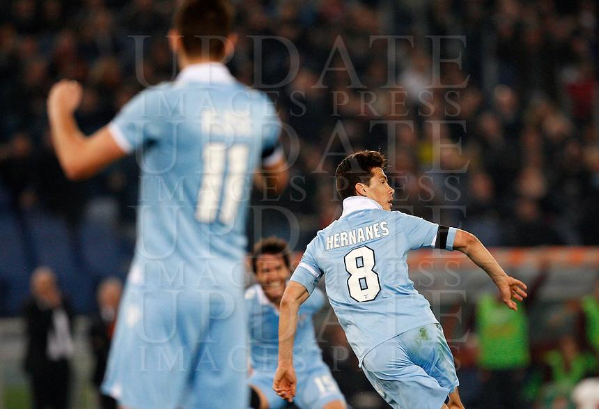 Calcio, Serie A: Roma vs Lazio. Roma, stadio Olimpico, 8 aprile 2013..Lazio midfielder Hernanes, of Brazil, right, celebrates with teammates after scoring during the Italian Serie A football match between AS Roma and Lazio at Rome's Olympic stadium, 8 April 2013..UPDATE IMAGES PRESS/Riccardo De Luca