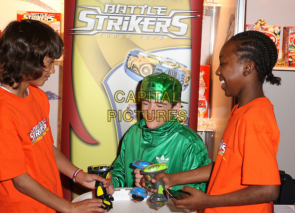GEORGE SAMPSON - BATTLE STRIKERS .Dream Toys 2009 exhibition, London, England, UK, October 28th 2009..half length green hat toy game playing shiny adidas top cap photocall promoting .CAP/JIL.©Jill Mayhew/Capital Pictures