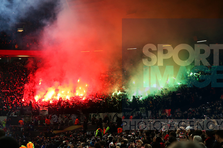 Saint-Etienne fans let off fireworks during the UEFA Europa League Round of 32 1st leg match at Old Trafford Stadium, Manchester. Picture date: February 16th, 2017. Pic credit should read: Matt McNulty/Sportimage