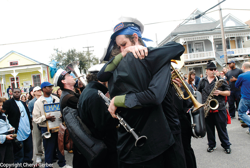 Mourners hug at funeral of Helen Hill, 2007