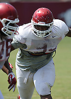 NWA Democrat-Gazette/ANDY SHUPE<br /> Arkansas defensive lineman DeMarcus Hodge takes part in a drill Thursday, Aug. 13, 2015, during practice at the university practice field in Fayetteville.