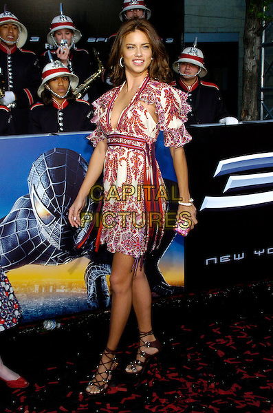 "ADRIANA LIMA.""Spider-Man 3"" US premiere during the 6th Annual Tribeca Film Festival held at United Artist Kaufman Astoria Cinema 14,  Queens, New York, USA,.30 April 2007..full length Gucci paisley print folk dress white red and purple ribbons strappy sandals shoes hand Hello Kitty purse.CAP/ADM/BL.©Bill Lyons/AdMedia/Capital Pictures. *** Local Caption ***"