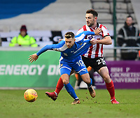 Notts County's Jorge Grant shields the ball from Lincoln City's Neal Eardley<br /> <br /> Photographer Chris Vaughan/CameraSport<br /> <br /> The EFL Sky Bet League Two - Lincoln City v Notts County - Saturday 13th January 2018 - Sincil Bank - Lincoln<br /> <br /> World Copyright &copy; 2018 CameraSport. All rights reserved. 43 Linden Ave. Countesthorpe. Leicester. England. LE8 5PG - Tel: +44 (0) 116 277 4147 - admin@camerasport.com - www.camerasport.com