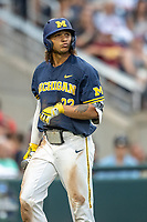 Michigan Wolverines outfielder Jordan Brewer (22) walks back to the dugout during Game 6 of the NCAA College World Series against the Florida State Seminoles on June 17, 2019 at TD Ameritrade Park in Omaha, Nebraska. Michigan defeated Florida State 2-0. (Andrew Woolley/Four Seam Images)