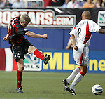 17 April 2004: John Wolyniec (15) powers a first half shot past Earnie Stewart (8). The MetroStars defeated DC United 3-2 at Giants Stadium in East Rutherford, NJ during a regular season Major League Soccer game..