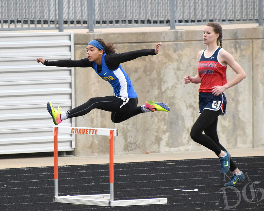 Photo by Mike Eckels<br /> <br /> Decatur's Desi Meek sails over a hurdle in the home stretch of the 100 meter hurdles during the Gravette High School Invitational Relays March 16 at Lion Stadium in Gravette. Meek captured first place in both the 100 and 300 meter hurdles to give Decatur a fourth place finish in the meet behind Gravette.