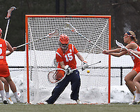 Free position shot eludes Syracuse University goalkeeper Kelsey Richardson (15).  Syracuse University (orange) defeated Boston College (white), 17-12, on the Newton Campus Lacrosse Field at Boston College, on March 27, 2013.