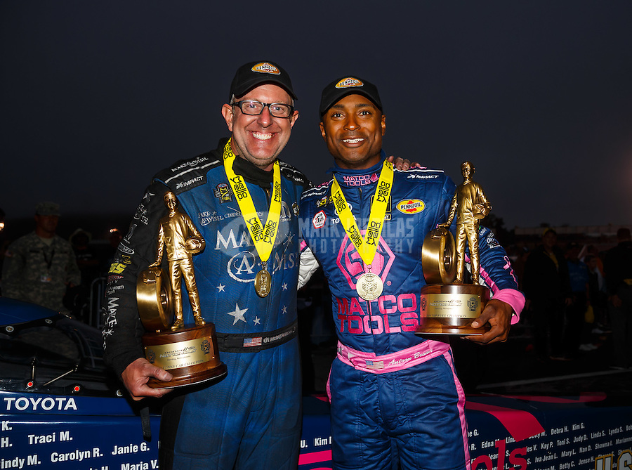 Oct 2, 2016; Mohnton, PA, USA; NHRA top fuel driver Antron Brown (right) celebrates with funny car teammate Tommy Johnson Jr after winning the Dodge Nationals at Maple Grove Raceway. Mandatory Credit: Mark J. Rebilas-USA TODAY Sports