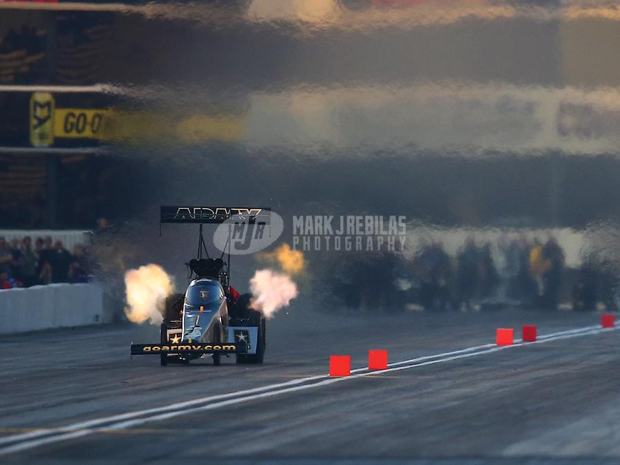 Feb 12, 2016; Pomona, CA, USA; NHRA top fuel driver Tony Schumacher during qualifying for the Winternationals at Auto Club Raceway at Pomona. Mandatory Credit: Mark J. Rebilas-USA TODAY Sports