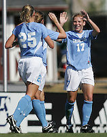 OCT 2, 2005: College Park, MD, USA:  UNC Tarheel midfielder #17 Lori Chalupny celebrates a goal with teammates while playing the Maryland Terrapins at Ludwig Field.  UNC won, 4-0. Mandatory Credit: Photo By Brad Smith(c) Copyright 2005 Brad Smith