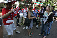 United States fans marching to Azteca stadium from the Zona Rosa District of Mexico City walk behind a Univision reporter conducting an interview. The United States Men's National Team played Mexico in a CONCACAF World Cup Qualifier match at Azteca Stadium in, Mexico City, Mexico on Wednesday, August 12, 2009.