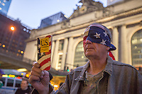 NEW YORK,NY APRIL 14: A blindfolded man by a US flag and a book of the United States Constitution during the anti-Trump protest in midtown Manhattan on April 14,2016 in New York City.Photo by VIEWpress/Maite H. Mateo
