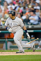 Jose Molina #26 of the New York Yankees follows through on his swing versus the Detroit Tigers at Comerica Park April 27, 2009 in Detroit, Michigan.  Photo by Brian Westerholt / Four Seam Images