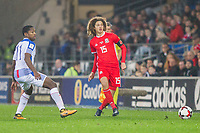 Ethan Ampadu of Wales passes clear of Armando Cooper of Panama during the International Friendly match between Wales and Panama at the Cardiff City Stadium, Cardiff, Wales on 14 November 2017. Photo by Mark Hawkins.