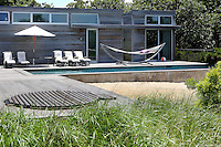 luxury pool area with hammock