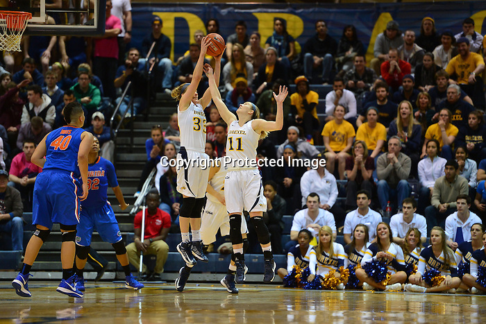 PHILADELPHIA - In the first 30 years and 123 days of Drexel women's basketball at the Division I level, the Dragons had never beaten a team from the Southeastern Conference. Over the next four days, Drexel would beat SEC teams twice. Days after winning at Auburn to earn a spot in the WNIT semifinals, the Drexel women's basketball team hosted Florida on Wednesday night and lead nearly the entire way as they beat the Gators and advanced to the 2013 WNIT championship game, 67-57. Hollie Mershon had 28 points and 10 assists, the latter a career high, to lead the Dragons.<br /> <br /> Drexel (27-10) led for the final 35:40 of play in defeating Florida (22-15), which had won its first four WNIT contests on the road. Fiona Flanagan got off to a hot start with five quick points, including a three-pointer which gave Drexel a 9-6 lead it would not relinquish, and finished with 11 points. Taylor Wootton dropped in 16 points, her ninth-straight game scoring in double figures.<br /> <br /> Sydney Rice led Florida with 20 points, 16 of which came in the first half. She also had a double-double, pulling down 10 of the Gators' 26 rebounds. Drexel outrebounded Florida 33-26 on the evening.<br /> <br /> Throughout the Dragons' run in the WNIT, Drexel has utilized its strong defense and timely shooting, putting teams away with extended scoring runs. The Dragons got another early run on Wednesday night. After trailing 6-4 with 16:44 remaining in hte first half, Flanagan scored the next five points for Drexel, keying an 11-0 run that extended over the next 3:49 of play. After Jennifer George knocked down a short jumper to get Florida back on the board, Flanagan answered with a three-pointer to push Drexel's advantage to 18-8, the first double-digit lead of the night for the Dragons.<br /> <br /> Playing in front of a raucous crowd of 1,412, the Dragons led by as many as 11 in the first half.<br /> <br /> The win puts Drexel into the WNIT championship game, where they will host the Utes 