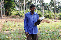 Felicien Kahonda, vice-president of the community nutrition group in Masi Manimba, in the Democratic Republic of the Congo, pictured in the community's allotments.