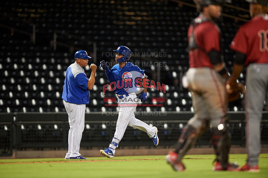 AZL Cubs 1 Yovanny Cuevas (24) is congratulated by manager Carmelo Martinez after hitting a solo home run during an Arizona League game against the AZL D-backs on July 25, 2019 at Sloan Park in Mesa, Arizona. The AZL D-backs defeated the AZL Cubs 1 3-2. (Zachary Lucy/Four Seam Images)