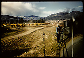 Freight passing lumber storage area. Chama area?<br /> D&amp;RGW  Chama area ?, NM