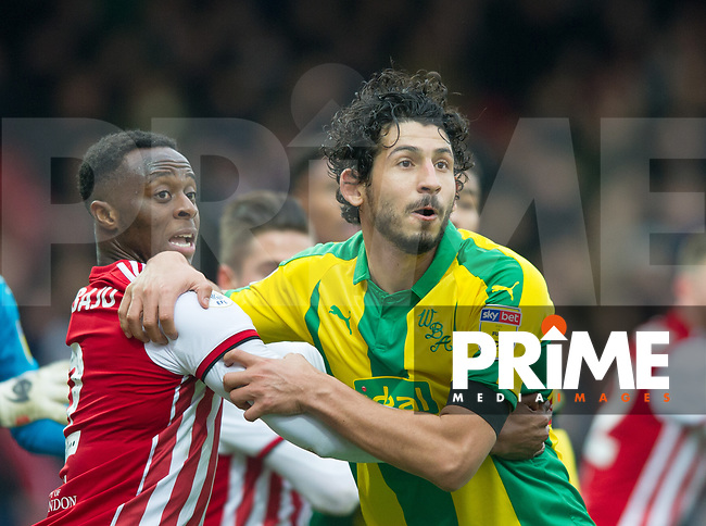 Brentford Moses Odubajo and WBA's Ahmed El-Sayed Hegazi during the Sky Bet Championship match between Brentford and West Bromwich Albion at Griffin Park, London, England on 16 March 2019. Photo by Andrew Aleksiejczuk / PRiME Media Images.